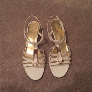 white and gold low heels
